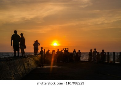 Crowd watching the sunset over the sea