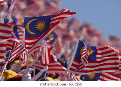 Crowd waving Malaysian flag