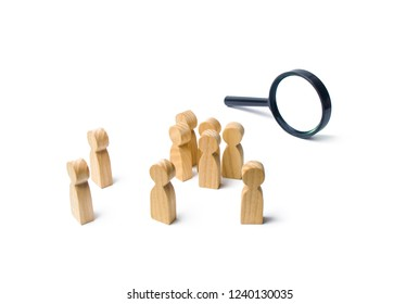 A crowd of wooden human figure stands near a magnifying glass on a white background. The concept of the search for people and workers. Search for vacancies and work. Human resources, management.