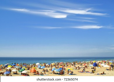 Crowded Atlantic summer beach in Carcavelos, Portugal