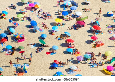 Crowded beach in a hot sunny summer day