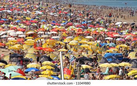 Crowded beach in summer in Scheveningen, Holland