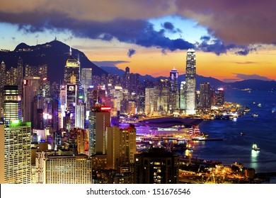 Crowded downtown and building in Hong Kong at sunset