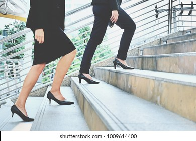 Crowded group of businesspeople walking on stair  in big city  with briefcase and laptop in hand, Business Lifestyle in modern city concept