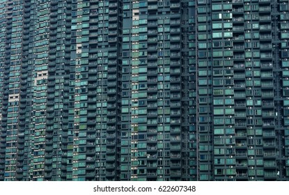A crowded Hong Kong street full of dense buildings.