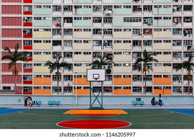 Crowded narrow apartments in the building of Choi Hung public housing estate in Kowloon, Hong Kong, with a basketball stand in the court, a phenomenon of severe housing shortage in Hongkong