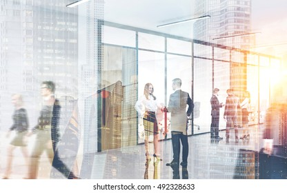 Crowded office. People are walking by. Pair shaking hands. Colleagues discussing business. Concept of human ant hill. Toned image. Double exposure