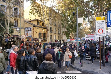 Crowded people shopping at El Rastro is the most popular open air flea market in Madrid , Spain in December 6,2015