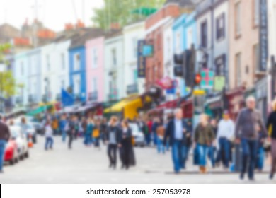 Crowded Portobello road, a famous area in London, blurred background