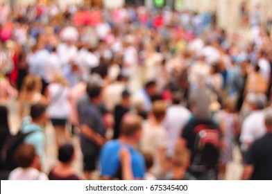 Crowded street and blurred people in motion