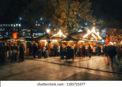 Crowded traditional christmas market at night with illumination on Rindermarkt in Munich, Germany.
