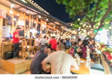 Crowded Traveler in pub at Thailand blur