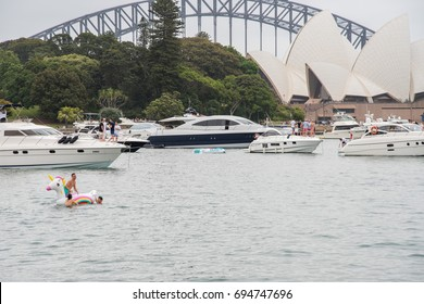 Crowds of concert goers in Farm Cove with yachts in Sydney, Australia/Unicorn Inflatable/SYDNEY,NSW,AUSTRALIA-NOVEMBER 19,2016: Concert lifestyle with yacht parties at Farm Cove in Sydney, Australia