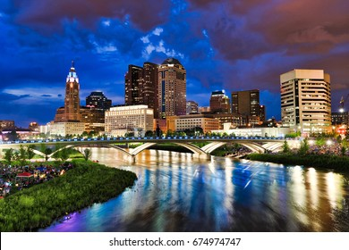 Crowds gather along the banks of the Scioto River In Columbus, Ohio in anticipation of the annual red, white and boom fireworks display