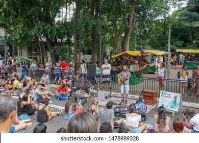 Crowds looking at music performances in Paulista Avenue on Sunday afternoon. Paulista Avenue is closed for vehicles every Sunday. Sao Paulo, Brazil. 02/24/2019