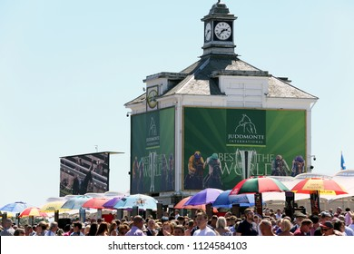Crowds pack into the inner Course Enclosure at York Racecourse with old Clock Tower in background : The Knavesmire, York Racecourse, North Yorkshire, UK : 30 June 2018 : Pic Mick Atkins