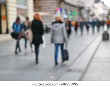 Crowds of people in shopping in the city,blur