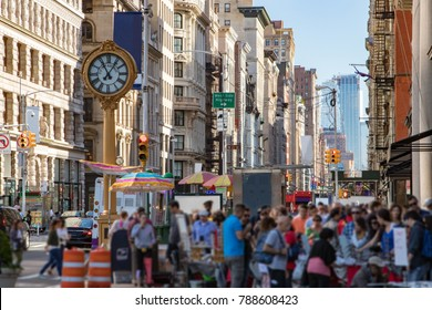 Crowds of people shopping at street vendors along the sidewalks of Fifth Avenue in Manhattan, New York City NYC