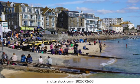 Crowds of people in St Ives harbour on sunny day, September 2020