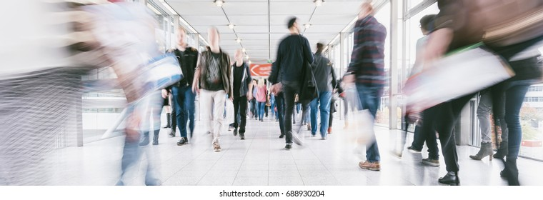 crowds of people walking in a shopping mall