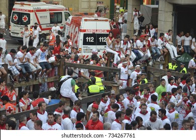 Crowds in traditional white shirts and red neck ties line the streets of Pamplona during the annual San Fermin festival. Basque country, Spain. - July 10, 2013