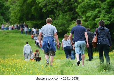 Crowds Walk through the Countryside