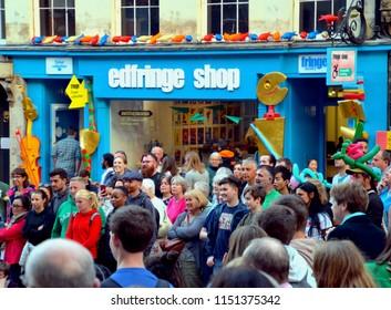 Crowds watching a street show outside the Edinburgh Fringe Box office on the Royal Mile, Edinburgh city centre, Scotland UK. August  2018