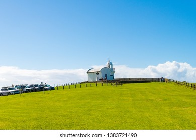 Crowdy Head Lighthouse, NSW, Australia-April 21, 2019: People visiting Crowdy Head Lighthouse, a headland between Forster and Port Macquarie, in New South Wales, Australia