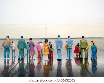 a crowed of plastic people on a old wooden floor with copy space