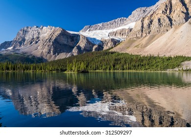 Crowfoot Glacier reflects on Bow Lake in Banff National Park.