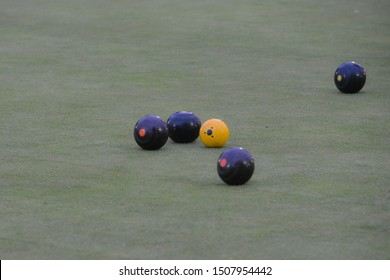 Crown green bowling balls on green.