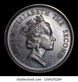 Crown on Queen Elizabeth the Second head on Hong Kong dollar coin 1987. Isolated.