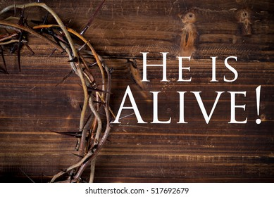 A crown on thorns, a religious symbol on a wooden background - Easter background