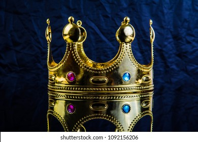 crown with precious stones on a blue background