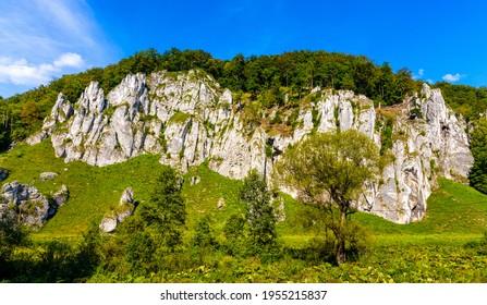 Crown rocks - Skaly Koronne - Jurassic limestone mountain massif with Glove Rock - Rekawica - in Pradnik creek valley of Cracow-Czestochowa upland in Lesser Poland - Shutterstock ID 1955215837