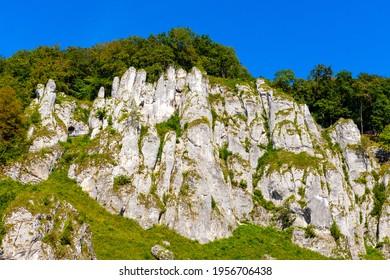 Crown rocks - Skaly Koronne - Jurassic limestone mountain massif with Glove Rock - Rekawica - in Pradnik creek valley of Cracow-Czestochowa upland in Lesser Poland - Shutterstock ID 1956706438