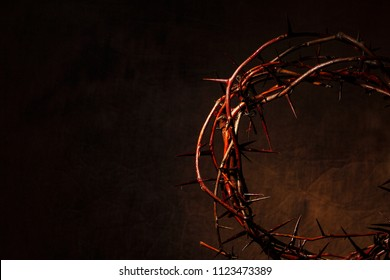 Crown of thorns illuminated on a dark background. Christian Background.