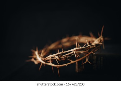The crown of thorns of Jesus upon holy bible on black  background with copy space, can be used for Christian background, Easter concept - Shutterstock ID 1677617200
