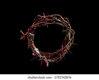 The crown of thorns lie on an isolated black background, with a red tint of light. The concept of Holy week, associated with suffering and love. Close up. - Shutterstock ID 1792743076