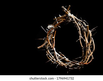 The crown of thorns lies on an isolated black background. The concept of Holy week, associated with suffering and love. Close up. - Shutterstock ID 1796941732