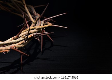 Crown Of Thorns On A Black Wooden Background - Shutterstock ID 1651745065