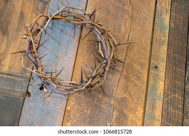 Crown of Thorns on Old Wood Table