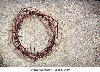A crown of thorns on a stone texture background - Shutterstock ID 1858572439