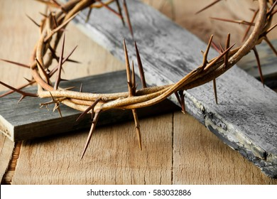 Crown of thorns on wood desk. Christian concept