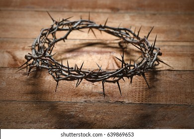 Crown of thorns on wooden table