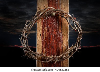 Crown of thorns over cross held by nail