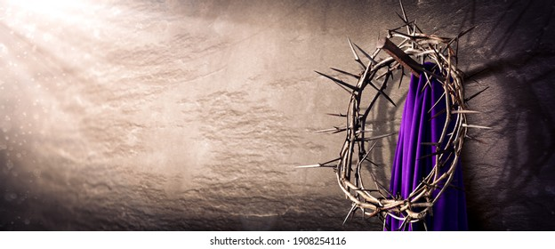 Crown Of Thorns And Purple Robe Hanging On Nail In Stone Wall With Light Rays  - Crucifixion Of Jesus Christ - Shutterstock ID 1908254116