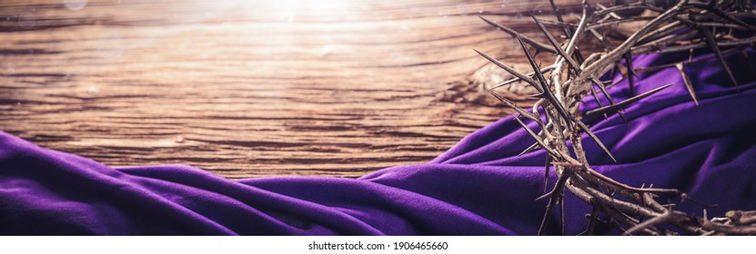 Crown Of Thorns And Purple Robe On Wooden Floor With Sunlight - Crucifixion Of Jesus Christ
