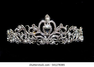Crown, wedding tiara, diadem isolated on black background