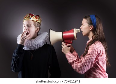 Crowned boy ignores the girl. Difficult teenager comminication concept.